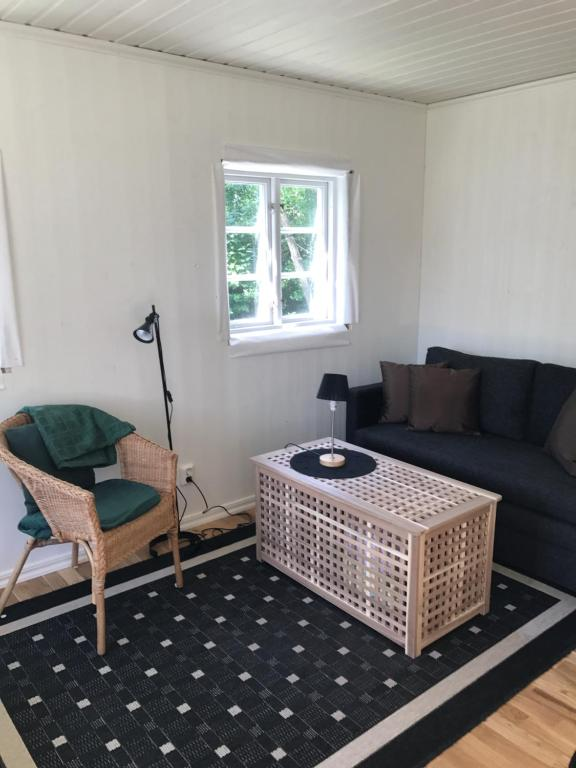 A seating area at Holiday Home/ Gårdshus