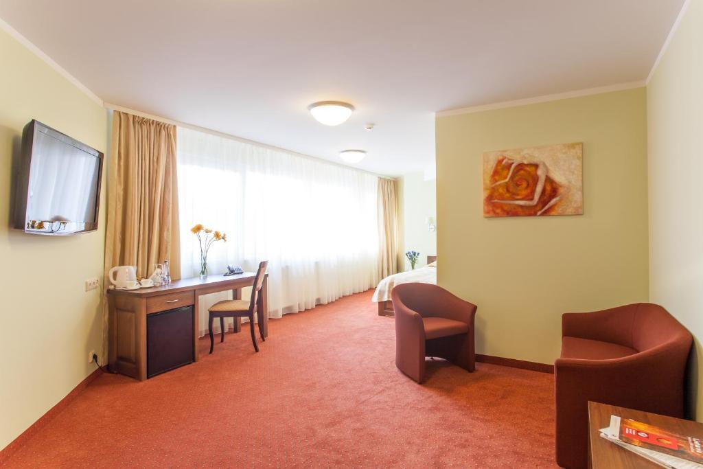 Svetainės erdvė apgyvendinimo įstaigoje AirInn Vilnius Hotel