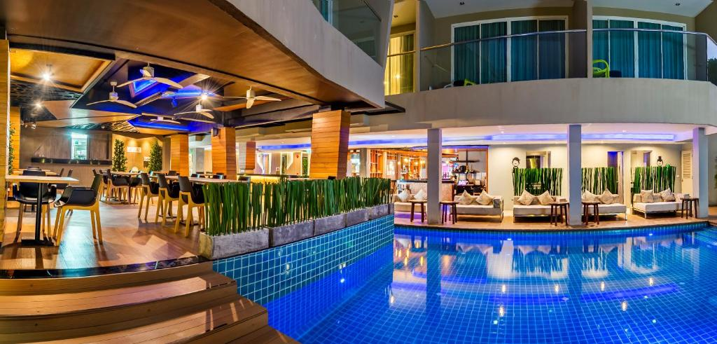 The swimming pool at or near New Nordic Ratana Suites