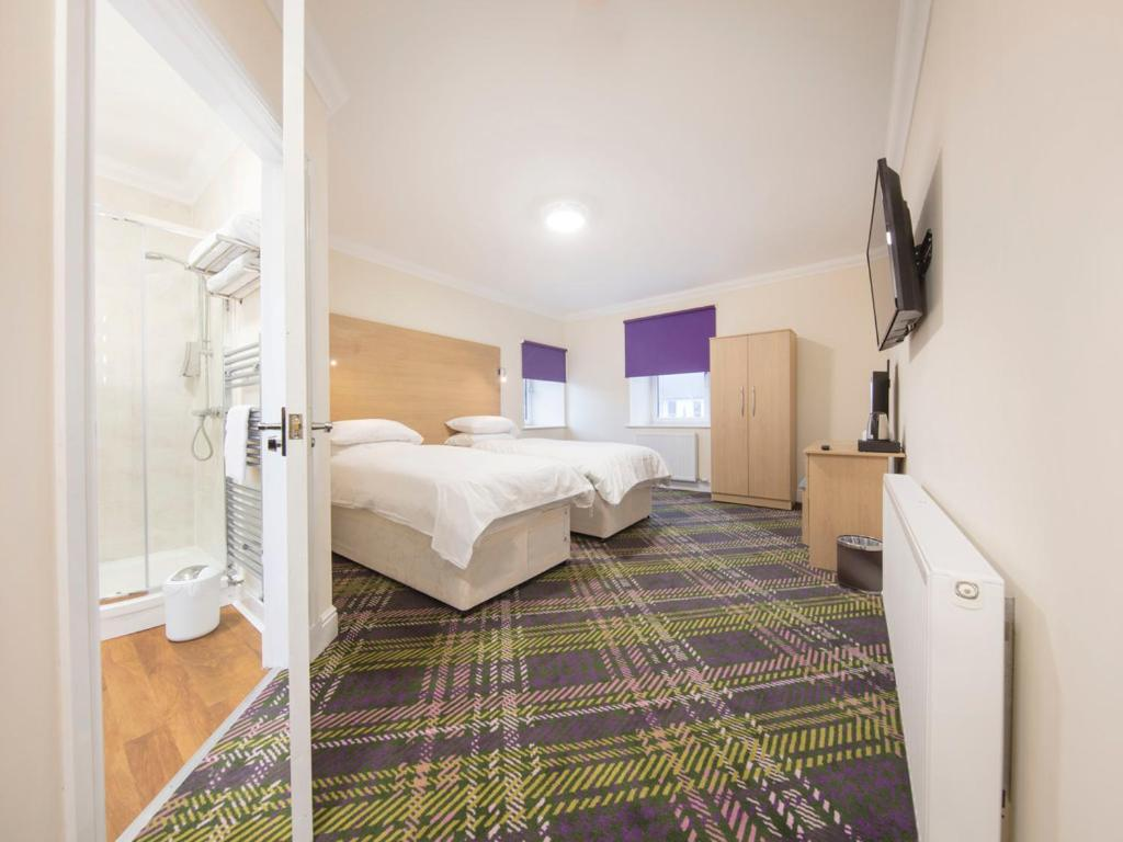 A bed or beds in a room at The Bay Horse
