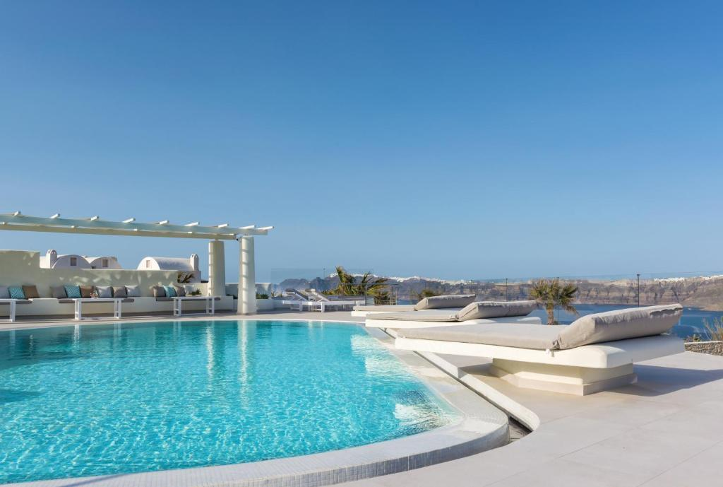 The swimming pool at or near Elements of Caldera Suites