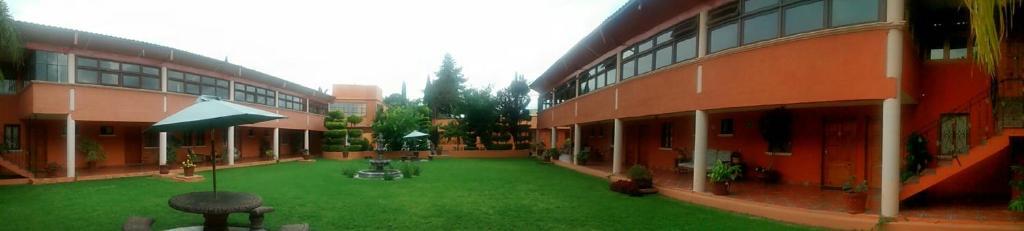 Piscina en o cerca de Hotel Ollin Teotl