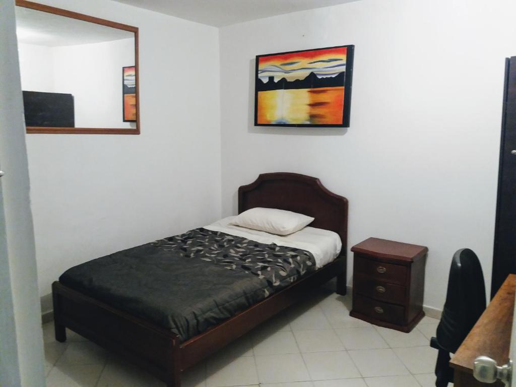 Postel nebo postele na pokoji v ubytování Alojamiento Casa Sara