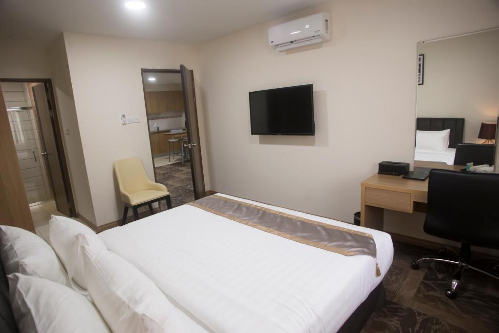 Кровать или кровати в номере Al Afiah Hotel