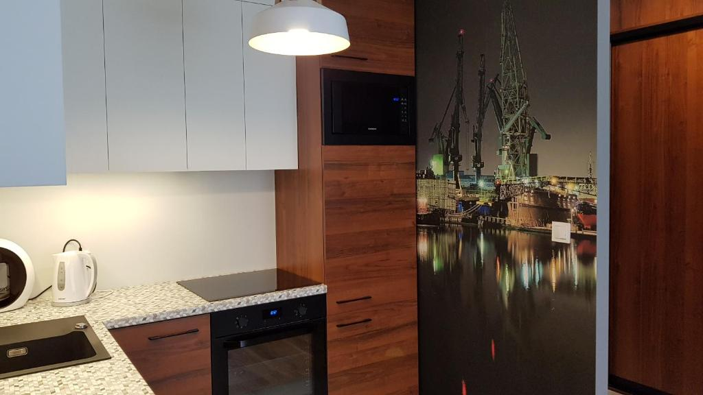 A kitchen or kitchenette at New apartment 100m from old town and marina