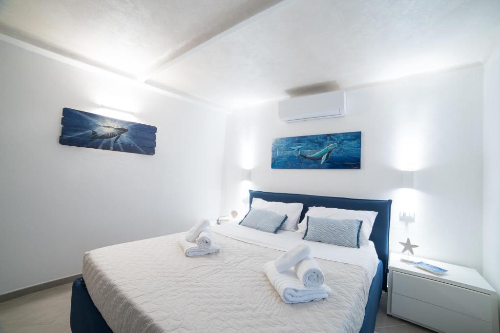 Un ou plusieurs lits dans un hébergement de l'établissement 330 Holiday Apartments Manarola