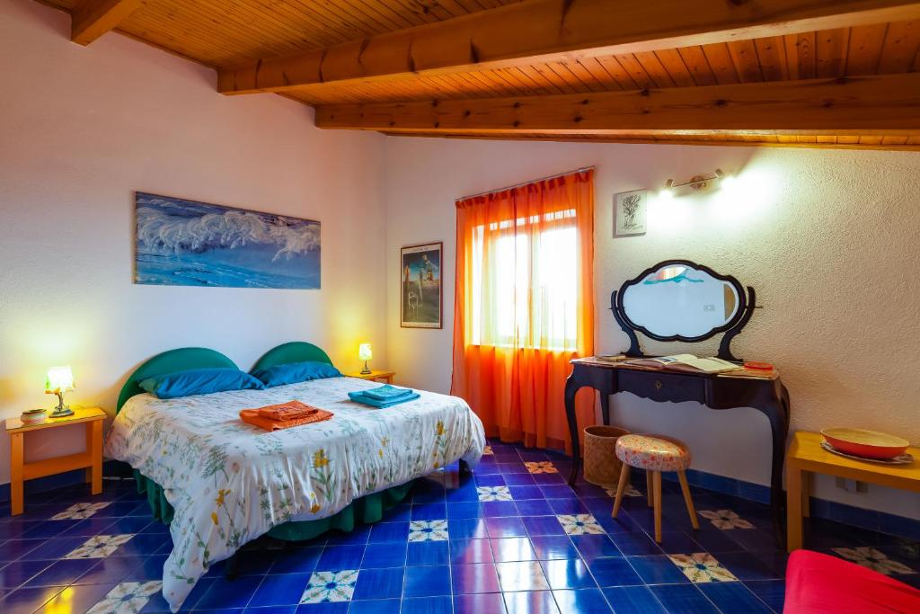 A bed or beds in a room at B&B Villa Conola