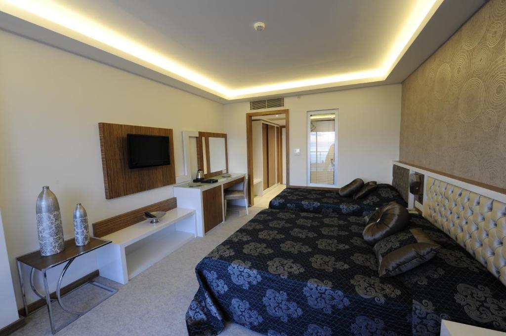 Кровать или кровати в номере Diamond Hill Resort Hotel