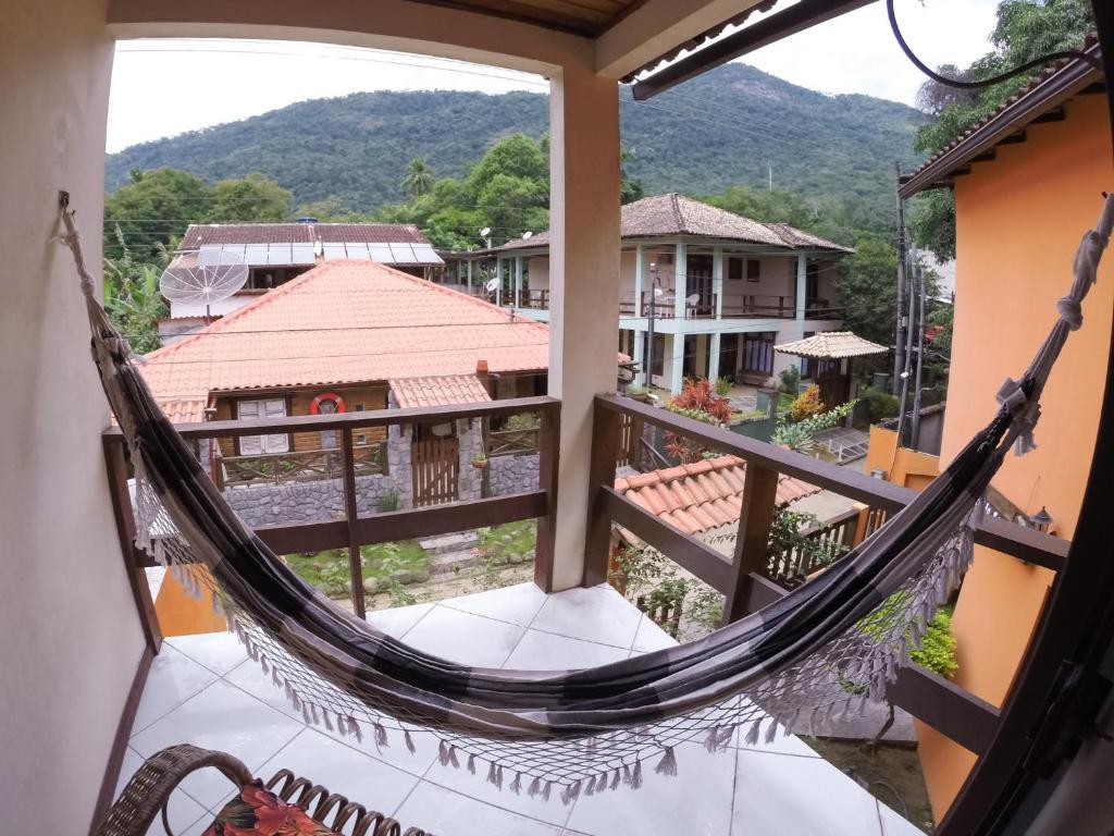 Uma varanda ou terraço em Pousada Recanto do Sabiá