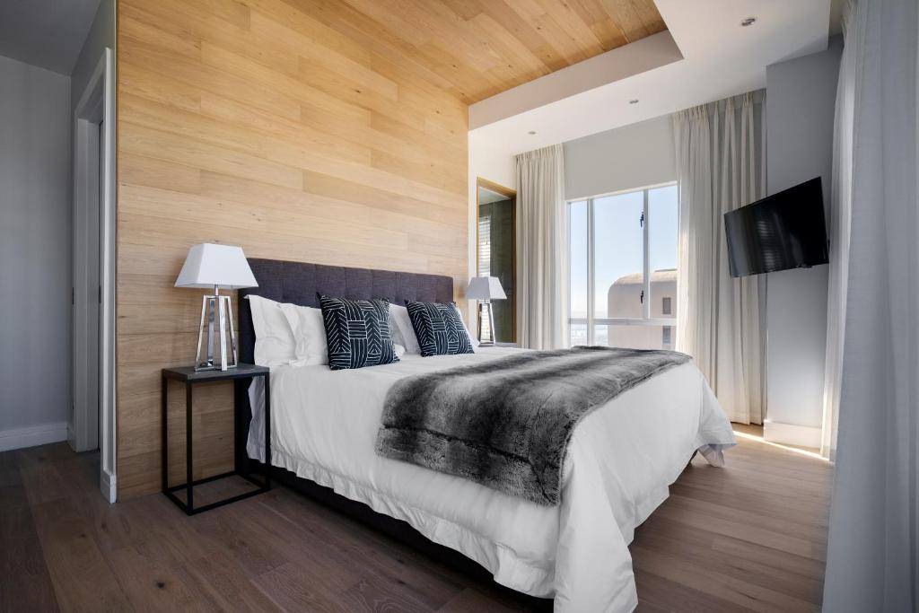 A bed or beds in a room at The Penthouse Collection