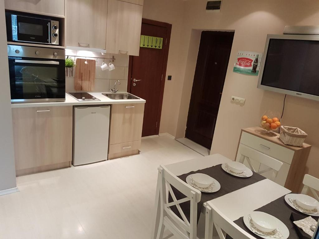 A kitchen or kitchenette at Apartment For You