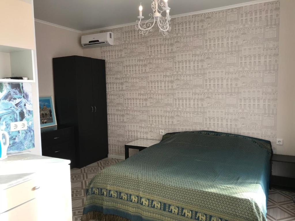 Кровать или кровати в номере Гостевой дом Белая Невесточка