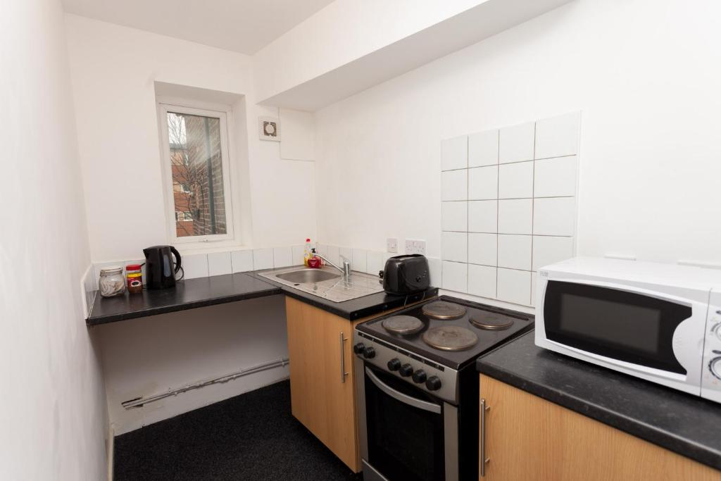 A kitchen or kitchenette at Budget Apartments