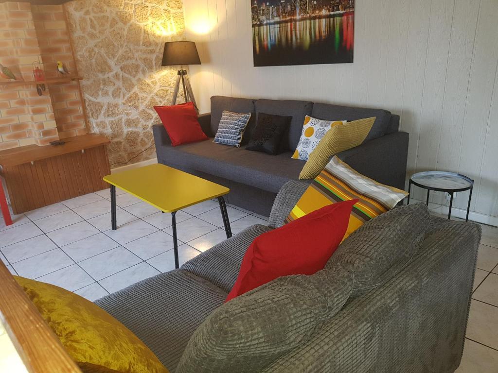 Coin salon dans l'établissement Duplex confort Marolles