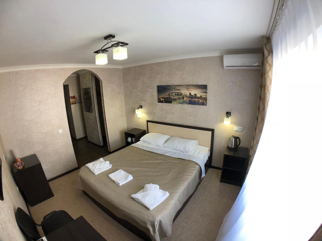 Кровать или кровати в номере Отель Нивки
