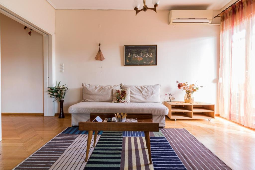 A seating area at Two-Bedroom Apartment -Kallirrois Athens