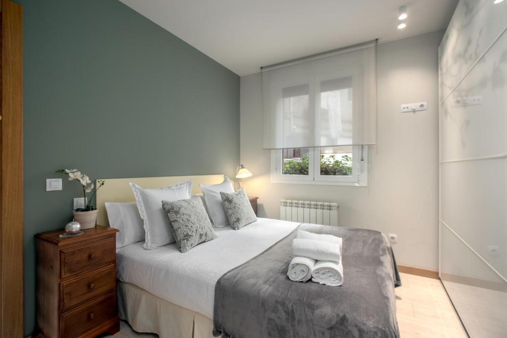 Cama o camas de una habitación en Ondarreta Beach Apartment