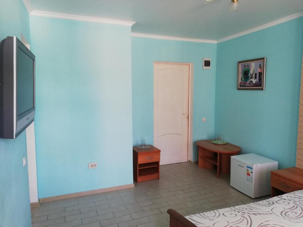 Телевизор и/или развлекательный центр в Гостевой Дом Ассоль