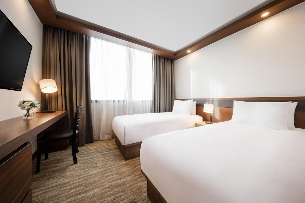 A bed or beds in a room at Gold Coast Hotel Incheon
