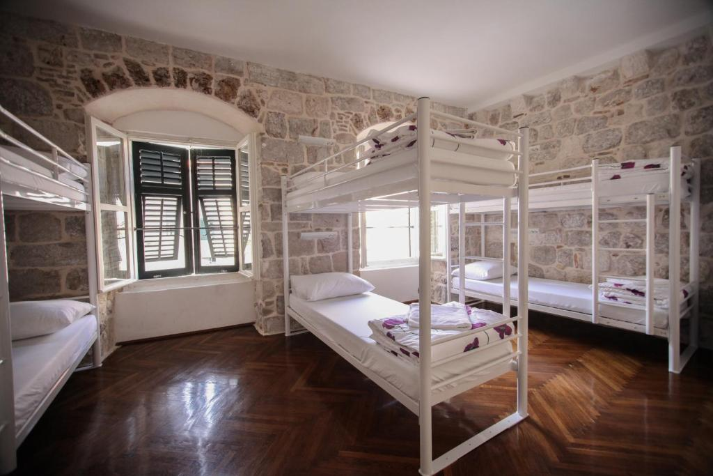 A bunk bed or bunk beds in a room at Hostel Angelina Old Town