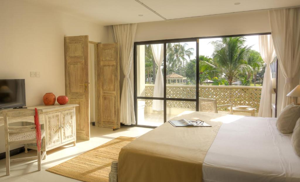 A bed or beds in a room at Sandies Malindi Dream Garden
