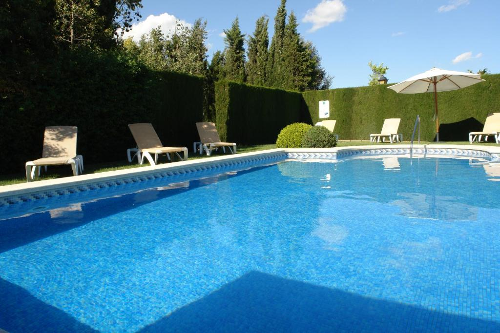 The swimming pool at or near Ad Hoc Parque Golf