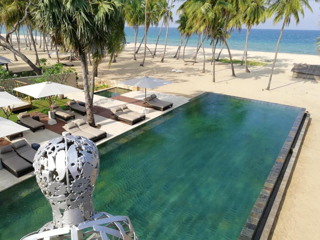 A view of the pool at Karpaha Sands or nearby