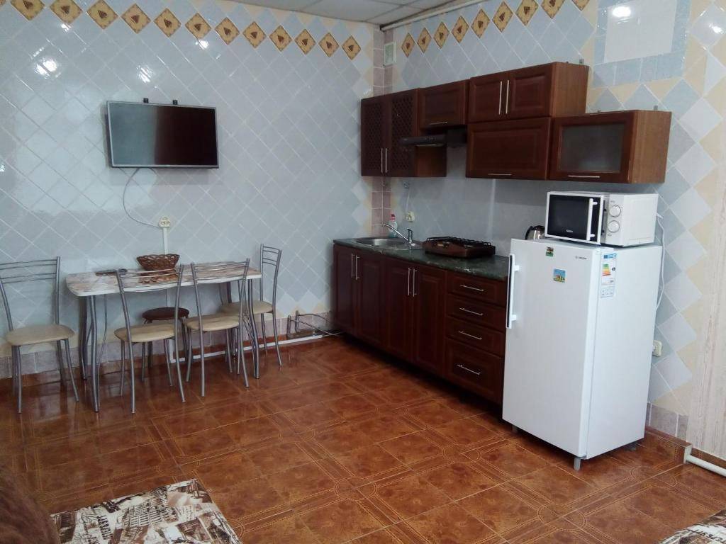A kitchen or kitchenette at Guest House Bereg Morya