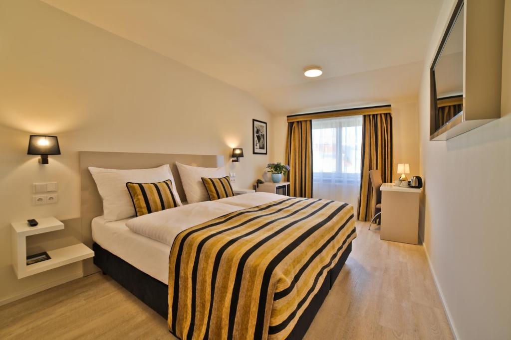 Postel nebo postele na pokoji v ubytování Ariston & Ariston Patio Hotel