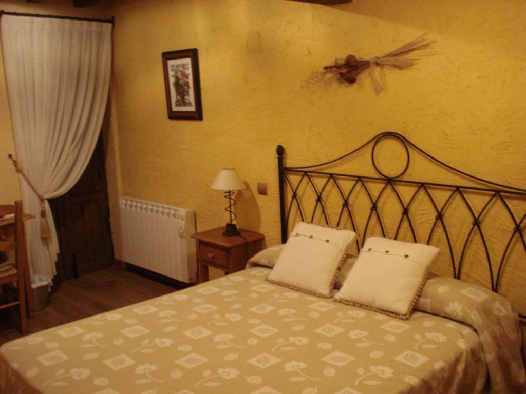 Cama o camas de una habitación en El Balcón de Mogarraz