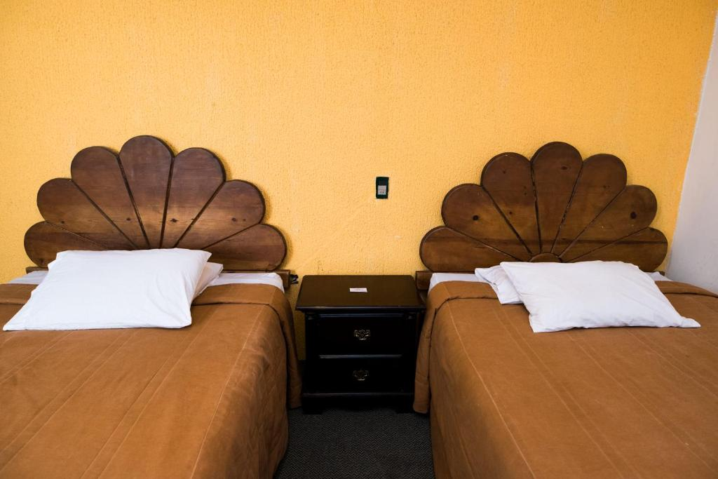 Cama o camas de una habitación en Hotel María Elena