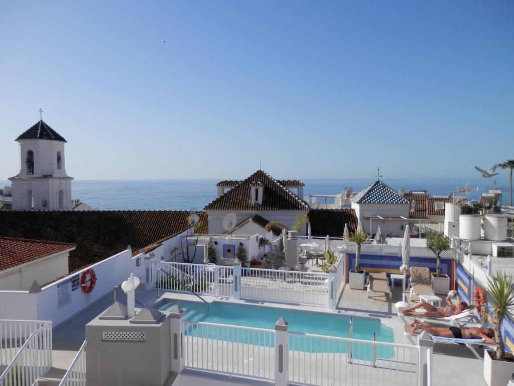 A view of the pool at Hotel Puerta del Mar or nearby