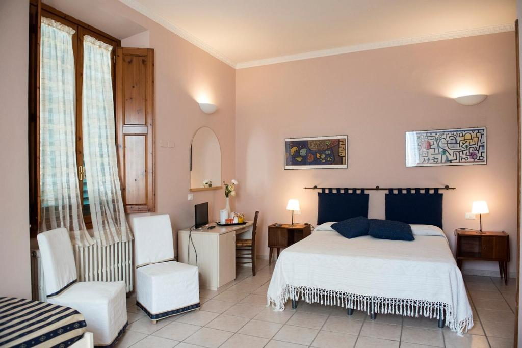 A bed or beds in a room at Affittacamere Benedetta