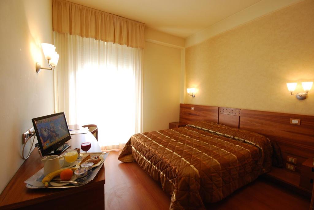 Letto o letti in una camera di Hotel Gala