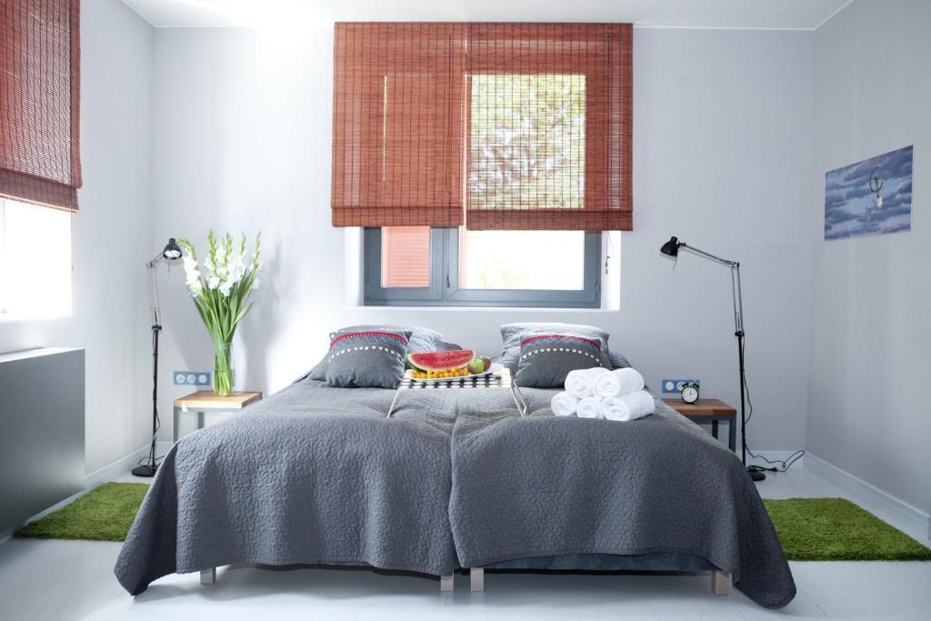 Łóżko lub łóżka w pokoju w obiekcie Republika Słoneczna