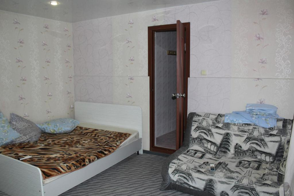A bed or beds in a room at Leoregul Guest House