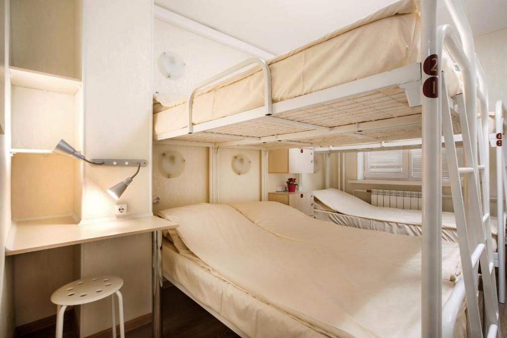 A bunk bed or bunk beds in a room at Hostel Uspenskiy Dvor