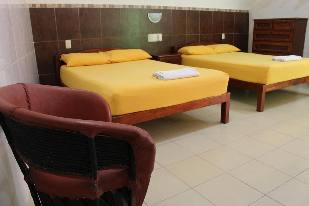 A bed or beds in a room at Hotel Pueblo Viejo