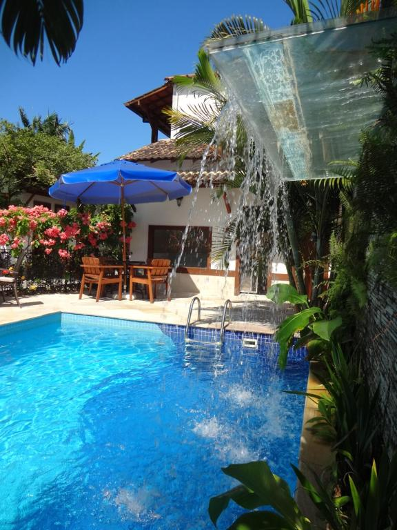 The swimming pool at or near Pousada Doce Paraty