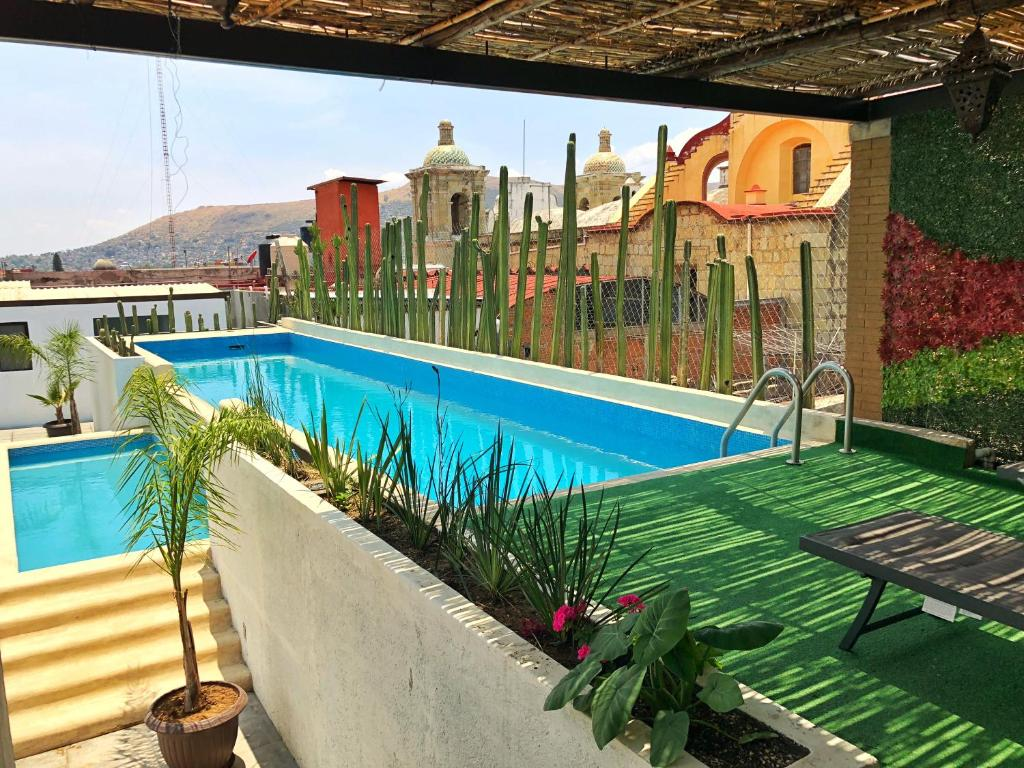 The swimming pool at or near Hotel Siglo XVII Art Gallery