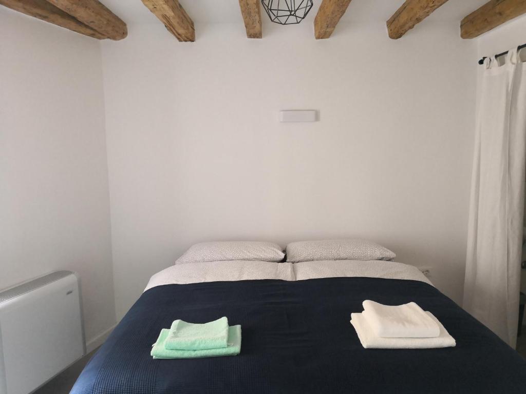 Postelja oz. postelje v sobi nastanitve M9 Rooms