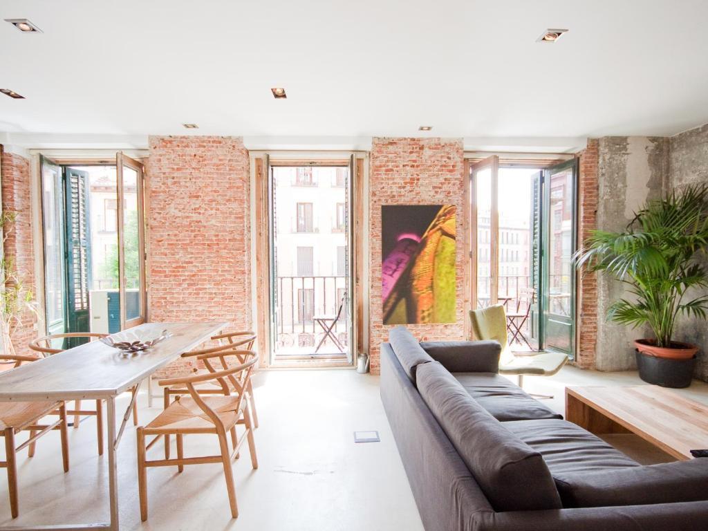 Ein Sitzbereich in der Unterkunft Gran apartamento de diseño @plazasanmiguel *lujo*