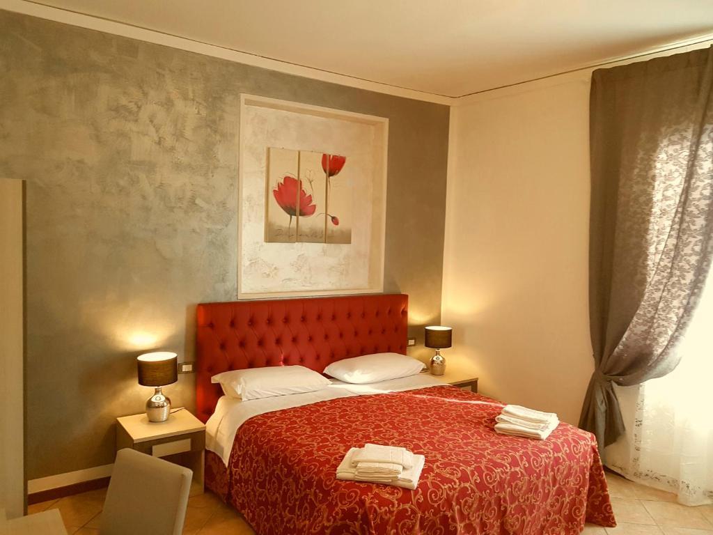 Een bed of bedden in een kamer bij B&B La Cittadella