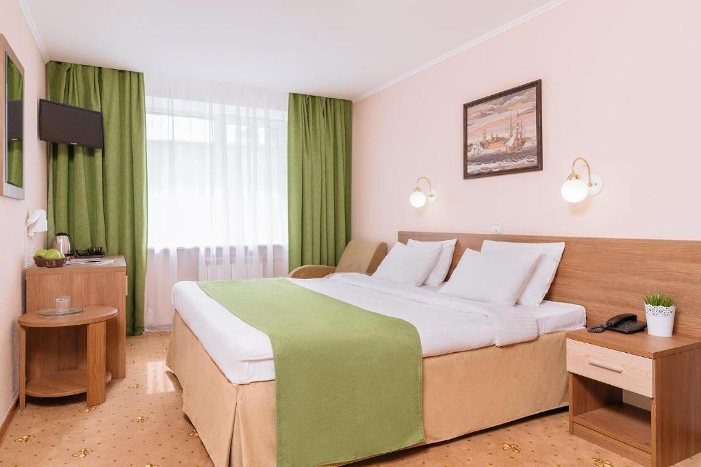 Кровать или кровати в номере Отель Полюстрово