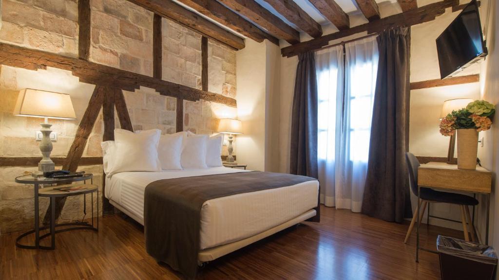Cama o camas de una habitación en Abad Toledo