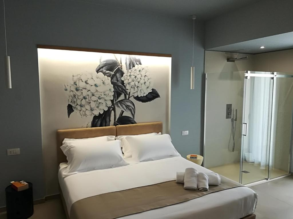 A bed or beds in a room at Villa Sece - Luxury Rooms