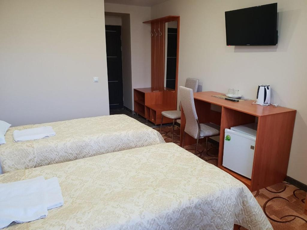 A bed or beds in a room at Zul Hotel
