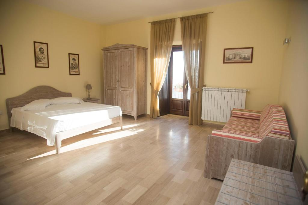 A bed or beds in a room at L'Antico Monastero