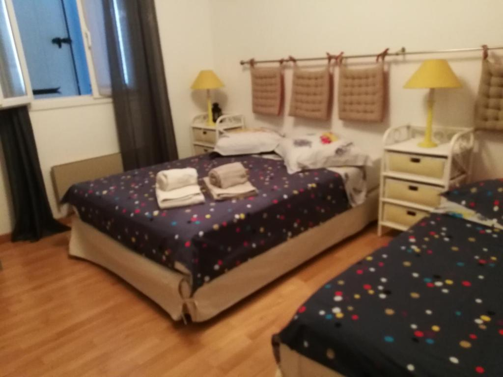 Un ou plusieurs lits dans un hébergement de l'établissement Oliveraie de la Leuziere