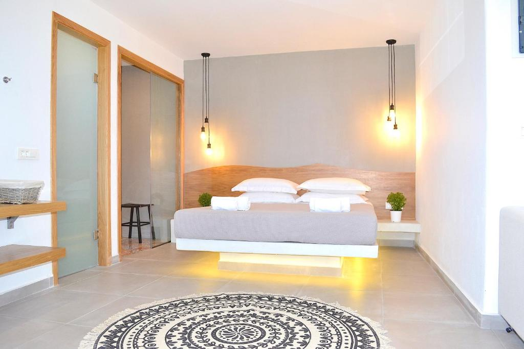 A bed or beds in a room at Lindos SeaSide Suite